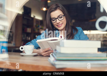 Hipster woman studying at cafe. Krakow, Poland - Stock Photo