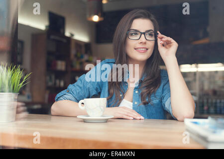 Portrait of beautiful woman at cafe. Krakow, Poland - Stock Photo