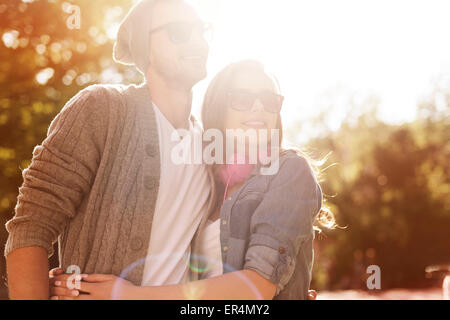 Portrait of hipster couple in sunny day. Krakow, Poland - Stock Photo