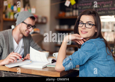 Stylish woman studying with her friend at cafe. Krakow, Poland - Stock Photo