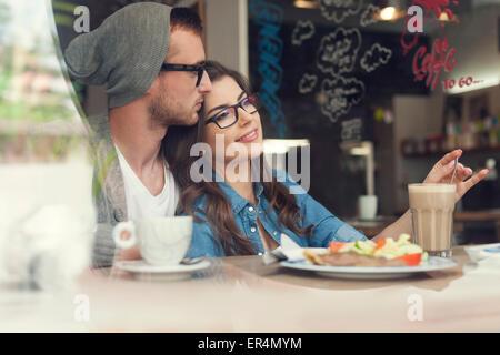 Romantic time of loving couple at cafe. Krakow, Poland - Stock Photo