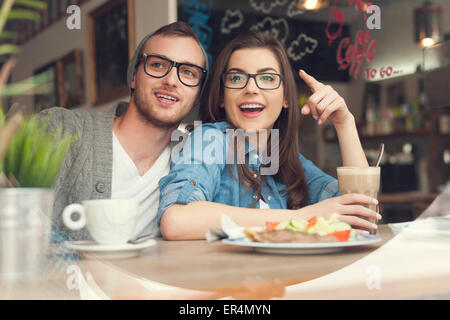Happy couple spending lunch time together in restaurant. Krakow, Poland - Stock Photo