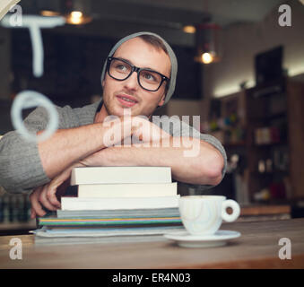 Dreaming nerdy male student in cafe. Krakow, Poland - Stock Photo
