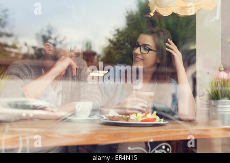 Young couple on a date at restaurant. Krakow, Poland - Stock Photo