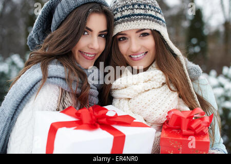 Lovely girls with Christmas gifts. Debica, Poland - Stock Photo