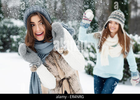 Young women have fun during the snowball fight. Debica, Poland - Stock Photo