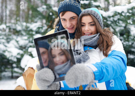Hey baby, smile! I'm taking selfie by digital tablet. Debica, Poland - Stock Photo