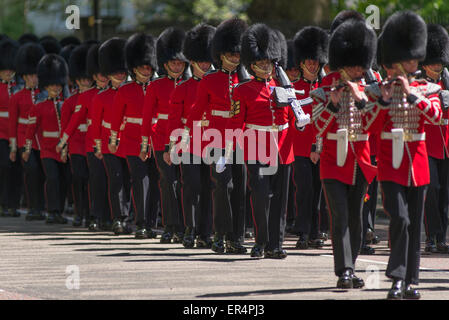 Westminster, London, UK. 27th May, 2015. Grenadier Guards march down sun dappled Birdcage Walk after the State Opening - Stock Photo