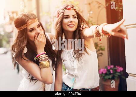 Two boho girls having fun on a summer day. Krakow, Poland - Stock Photo