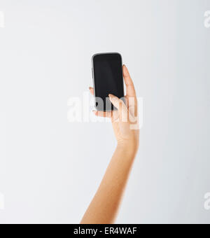 Woman using contemporary mobile phone. Debica, Poland - Stock Photo