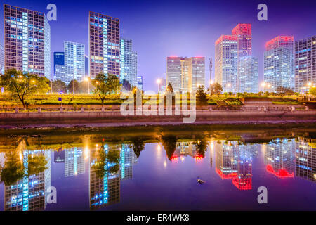 Beijing, China Central Business District city skyline on the Tonghui River. - Stock Photo