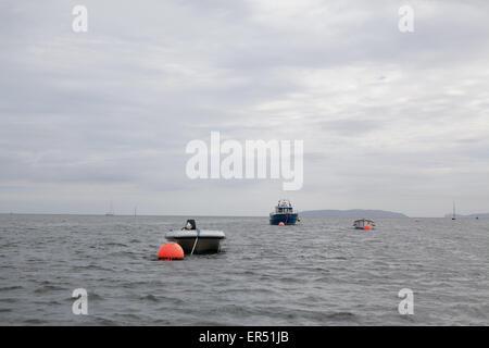 Boats and buoys near Beaumaris - Stock Photo
