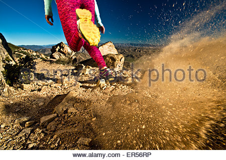 A girl runs on the Pacific Crest Trail in California. - Stock Photo