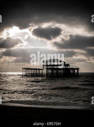 Brighton pier at sunset - Stock Photo