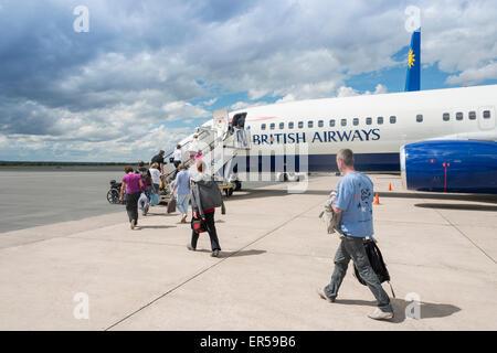 Passengers boarding British Airways (Comair) Boeing 737 at Hosea Kutako International Airport, Windhoek, Republic - Stock Photo