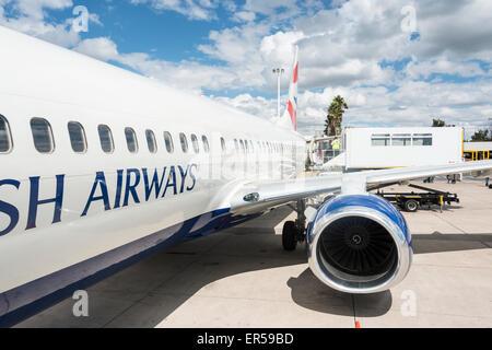 Loading disabled passenger on British Airways (Comair) Boeing 737 at Hosea Kutako International Airport, Windhoek, - Stock Photo