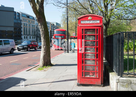 London red double-decker bus and telephone box, Knightsbridge, London, England, United Kingdom - Stock Photo