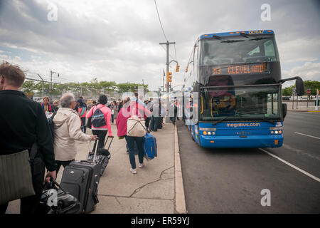 Travelers board an inter-city bus in New York on Friday, May 22, 2015 to escape the city over the Memorial Day weekend. - Stock Photo