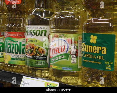 A selection of different brands of canola oil are seen on a supermarket shelf in New York on Thursday, May 21, 2015. - Stock Photo
