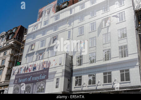 Scaffolding mural covering The Park Lane Hotel (Sheraton), Piccadilly, Mayfair, London, England, United Kingdom - Stock Photo