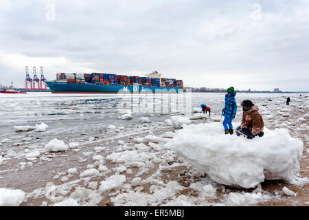 Children playing in the ice, Hamburg, Germany - Stock Photo