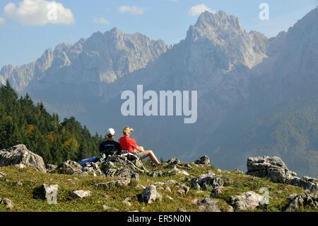 Hiking in the Kaiser valley, Kaiser mountain range over Kufstein, Tyrol, Austria - Stock Photo