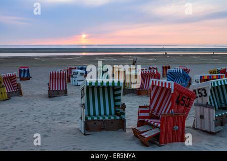 Beach chairs at sunset on the beach, Langeoog Island, North Sea, East Frisian Islands, East Frisia, Lower Saxony, - Stock Photo