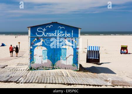 Beach chairs on the beach with rental hut, Juist Island, North Sea, East Frisian Islands, East Frisia, Lower Saxony, - Stock Photo