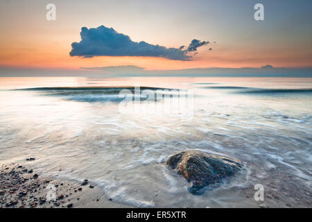Stone on the beach in the evening light, Baltic Sea, Nienhagen, Mecklenburg-Vorpommern, Germany - Stock Photo