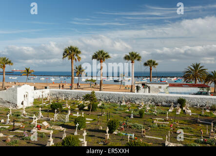 Ancient cementery with beach and palm trees in the background, Playa de las Teresitas, near San Andres, coast, Atlantic - Stock Photo