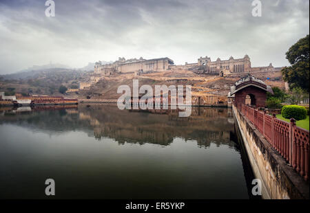 Amber fort on the hill at overcast sky in Jaipur, Rajasthan, India - Stock Photo
