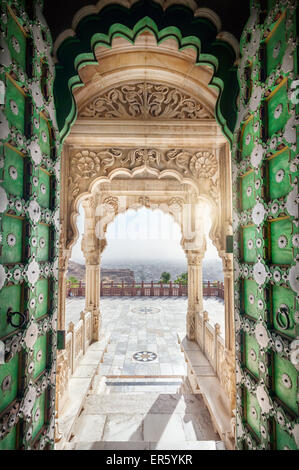 Jaswant Thada memorial with opened green door with view to Jodhpur city in Rajasthan, India - Stock Photo