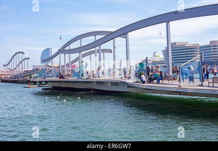 People strolling on bridge Rambla de mar in Barcelona - Stock Photo