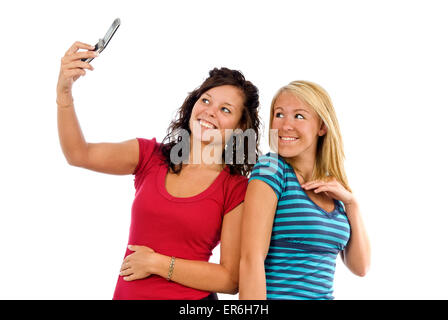 Two Girl Friends Taking A Selfie Picture On White Background - Stock Photo