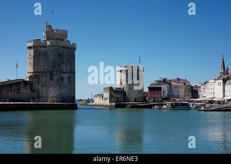 Old harbor Entrance showing St Nicolas Tower and Chain Tower Vieux Port  La Rochelle France. - Stock Photo