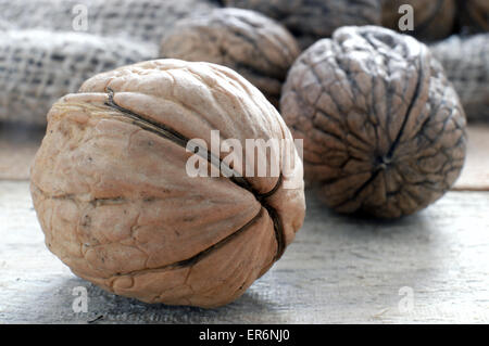 Some walnuts on a sack in a rustic kitchen, macro - Stock Photo