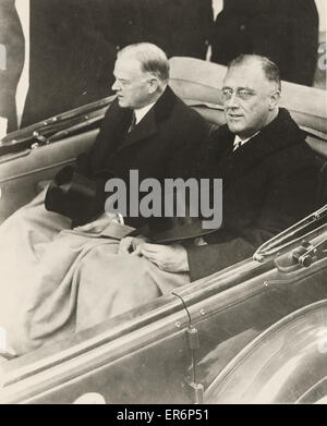 Franklin Delano Roosevelt and Herbert Hoover in convertible automobile on way to US Capitol for Roosevelt's inauguration, - Stock Photo