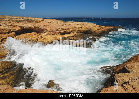 Waves crash on the rocks of Koufonissi in the Greek Islands. - Stock Photo