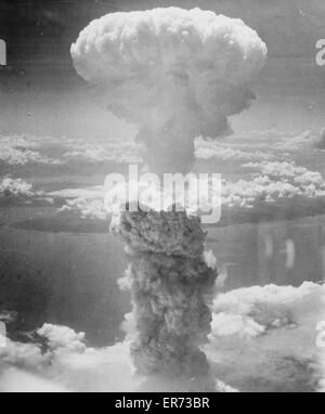 Bikini attol (in the Pacific ocean). Aerial view of clouds raised by test explosion of an atomic bomb. Date 1946. - Stock Photo