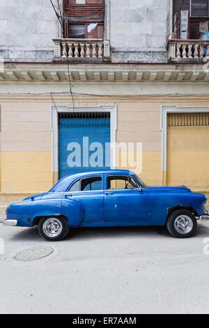 Street Scene with Blue Classic American Car, Havana Vieja, Cuba - Stock Photo