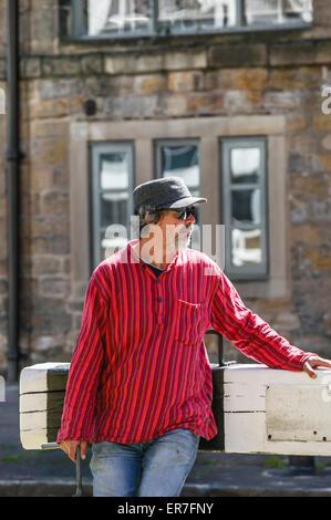 Man with Pink Stripe Shirt Pushing Open Lock Gates, Leeds Liverpool Canal, Granary Wharf Stock Photo