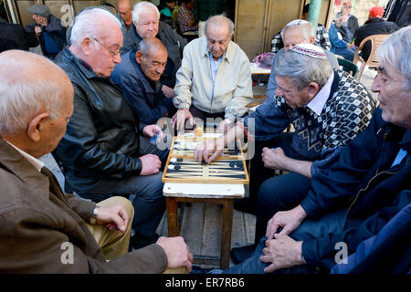 JERUSALEM - MAR 25 2015:Elderly men play backgammon in Mahane Yehuda Market in Jerusalem, Israel. Backgammon is - Stock Photo