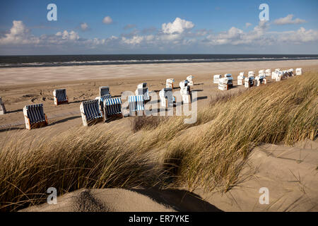 Strandkorb - beach chairs on the main beach, East Frisian Island Spiekeroog, Lower Saxony, Germany - Stock Photo