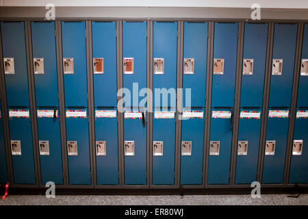 A row of lockers in a school hallway. - Stock Photo
