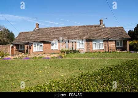 Semi-detached bungalow housing in village of Sutton, Suffolk, England, UK - Stock Photo