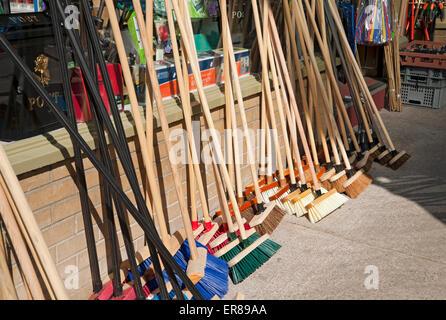 Brushes for sale outside hardware shop Harrogate North Yorkshire England UK United Kingdom GB Great Britain - Stock Photo
