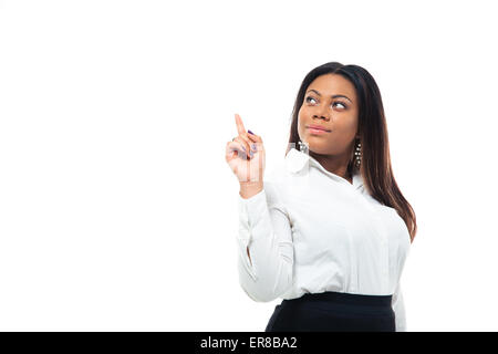 Afro american businesswoman pointing finger up isolated on a white background. Looking up - Stock Photo