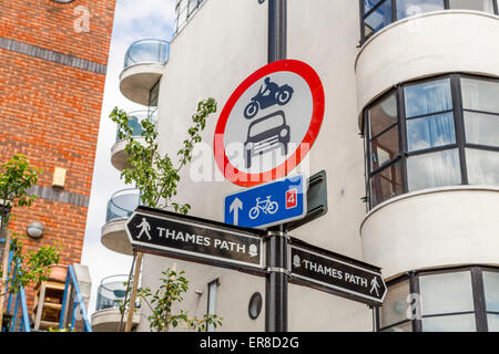 A sign showing the direction to the River Thames Path - Stock Photo
