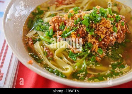 Minced meat and herbal spices noodle hot soup oriental style - Stock Photo
