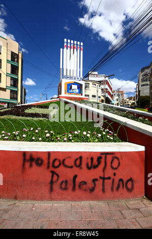 The words Palestine Holocaust and a defaced monument in protest against the Israeli military offensive in Gaza, - Stock Photo